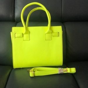 Brand new never worn bag with strap!